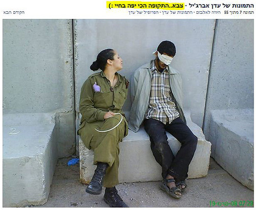 Israeli Soldier Eden Abergil Facebook photo - Eden Aberjil sitting legs crossed